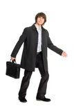 Young business man in a raincoat Stock Images