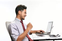 Young business man raising his hand feeling happy Stock Photos