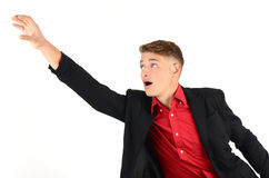 Young business man reaching up in desperation. Stock Photos