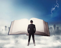 Young business man reading big book Royalty Free Stock Image