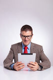 Young business man reading from tablet stock images