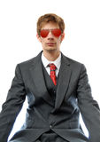Young business man with red aviators. Direct young business man in suit with red aviator sunglasses Royalty Free Stock Photography