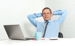Young business man relaxing on chair Stock Photos
