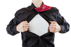 Young business man revealing a superhero suit Stock Images