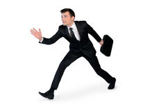 Young business man running. Isolated young business man running Royalty Free Stock Photo