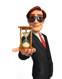 Young Business Man with sand clock Royalty Free Stock Images
