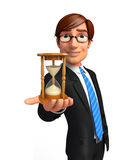 Young Business Man with sand clock Stock Image