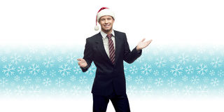 Young business man in santa hat showing empty space over winter Stock Images