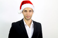 Young business man with a Santa hat. On a white background stock photos