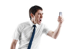 Young business man screaming in his cellphone. Isolated on white Stock Photos