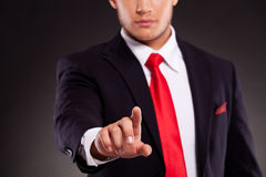 Young business man selecting something Stock Images