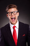 Young business man shouting Stock Images