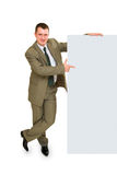 Young business man show blank. Young business man show in the finger at a white paper on white background Royalty Free Stock Photo
