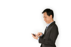 Young business man show mobile phone. Young business man happy using smart phone Royalty Free Stock Image