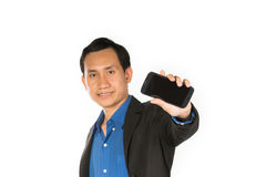 Young business man show mobile phone. Young business man happy using smart phone Royalty Free Stock Images