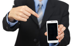 Young business man showing with black display of mobile phone Stock Photos