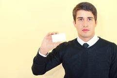 Young business man showing a blank business card Stock Photography