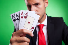 Young business man showing four aces Stock Photos
