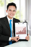 Young business man showing growth chart Stock Photography