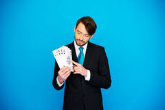 Young business man showing playing cards Stock Photo