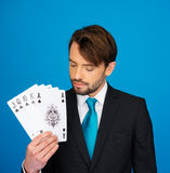 Young business man showing playing cards - Stock Photos