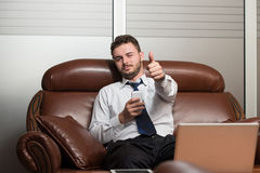 Young Business Man Showing Thumbs Up Royalty Free Stock Images