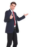 Young business man showing the thumbs up gesture Stock Image
