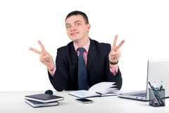 Young business man showing victory sign on grey background. Young business man showing victory sign isolated on white background.Office, finances, internet Royalty Free Stock Photos