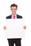 Young business man showing you blank board Royalty Free Stock Images