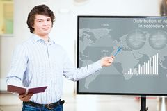 Young business man shows on the monitor charts Stock Photo