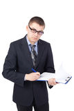 Young business man signing documents Royalty Free Stock Photo