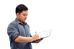 Young business man signing documents Royalty Free Stock Photography