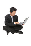 Young business man sit using notebook Royalty Free Stock Photos