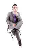 Young business man sitting on a chair Royalty Free Stock Photo