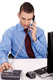 Young business man sitting at his desk Stock Photography