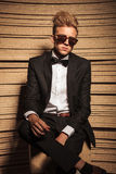 Young business man sitting with his legs crossed. Looking at the camera Stock Photos