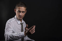 Serious young business man inviting you Royalty Free Stock Image