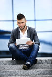 A young business man sitting on steps Royalty Free Stock Photography