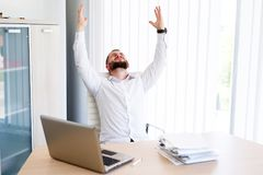 Young Businessman Has Very Stressful Day At Work. Young - Business Man Sitting At Workplace - In office Royalty Free Stock Image
