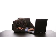 Young business man sleeping. On the laptop stock image
