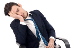 Young business man sleeping in the chair. Royalty Free Stock Images