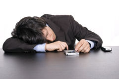 Young business man sleeping on the desk Royalty Free Stock Images