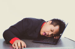 Young business man sleeping on his laptop Royalty Free Stock Photo