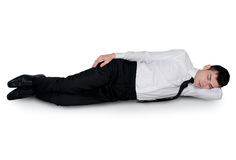 Young business man sleeping royalty free stock image