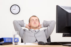 Young business man sleeping at work Stock Image