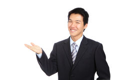 Young business man smile. Introduce with hand gesture Stock Image