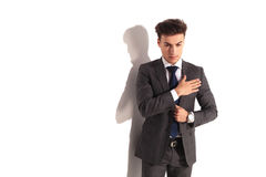 Young business man in solemn pose with hand on chest. On white studio background Royalty Free Stock Photography