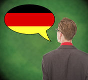 Young business man speaking german on school board. Background Royalty Free Stock Images