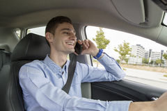 Young business man speaking on his phone inside car Royalty Free Stock Photography