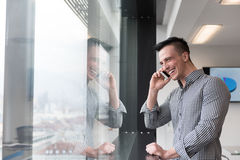 Young business man speaking on  smart phone at office Stock Images